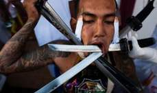 تايلاند تحتفل بالمهرجان النباتي بتخريم الأجساد لتطهير النفس