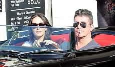 سايمون كاول وحبيبته في جولة رومانسية بسيارته الباهظة الثمن
