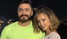 بالصورة- تامر حسني وزوجته بسمة بوسيل يحتفلان بعيد ميلاده بالثياب نفسها