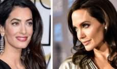 ما حقيقة الخلاف بين أنجلينا جولي وأمل كلوني؟ وما علاقة براد بيت بالموضوع؟