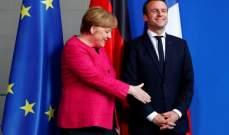 الرئيس الفرنسي يحرج المستشارة الألمانية ويمتنع عن مصافحتها ..والسبب