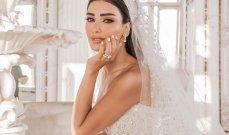 فستان زفاف جيسيكا عازار ملكي..وجمالها خطف الأنظار