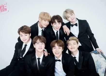 """فرقة BTS الكورية تعرض ملابس أعضائها في كليب """"داينامايت"""" للبيع"""