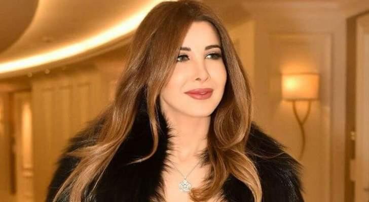 إبن محامية سارق بيت نانسي عجرم بصورة معها فما القصة؟- بالصورة
