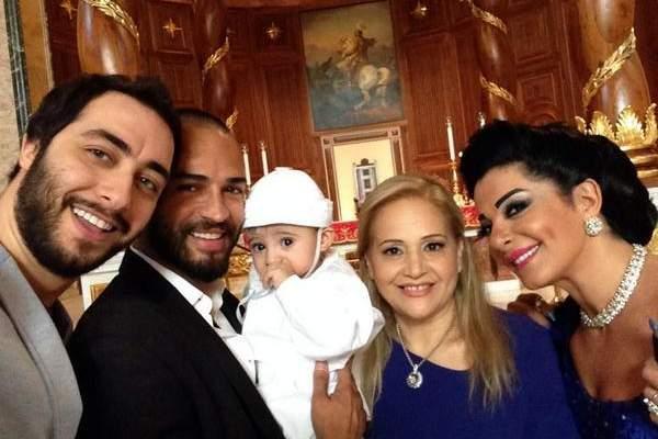 وسام حنا ينشر صور معمودية شربل ابن عادل كرم
