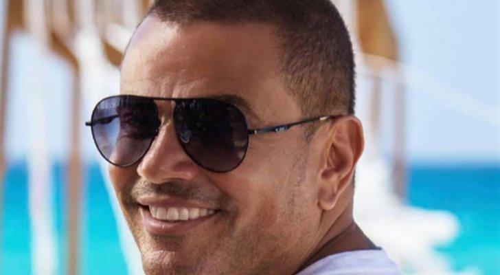 """عمرو دياب يكشف عن الإعلان الدعائي لـ """"أحلى ونص""""-بالفيديو"""