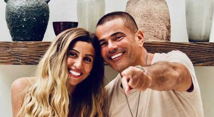 عمرو دياب يثير ضجة كبيرة بصورة لفتاة مجهولة والجمهور يسأل عن دينا الشربيني