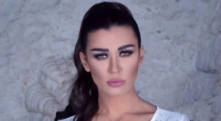 """بالفيديو- نادين الراسي تتأثر بأحداث مسلسل """"خمسة ونص"""" وتعلق على تعنيف المرأة"""