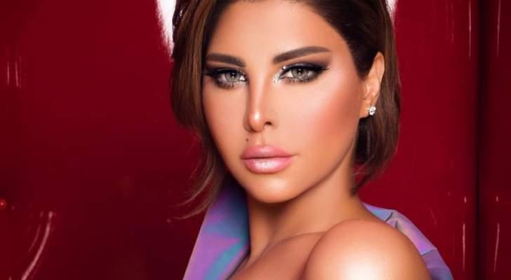 """شمس الكويتية تستعرض وشمها الذي يغطي ظهرها وتوجه رسالة الى الرجل """"النسونجي"""""""
