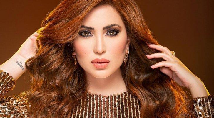 نسرين طافش تعايد متابعيها بالحجاب  - بالصورة