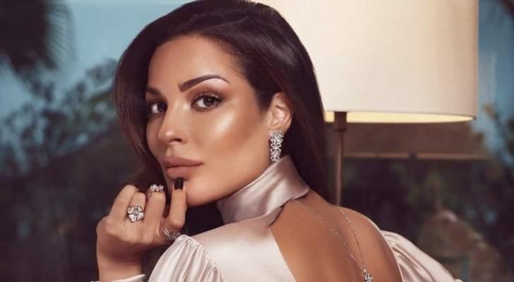 نادين نسيب نجيم تحتضن طفليها وتقبلهما - بالفيديو