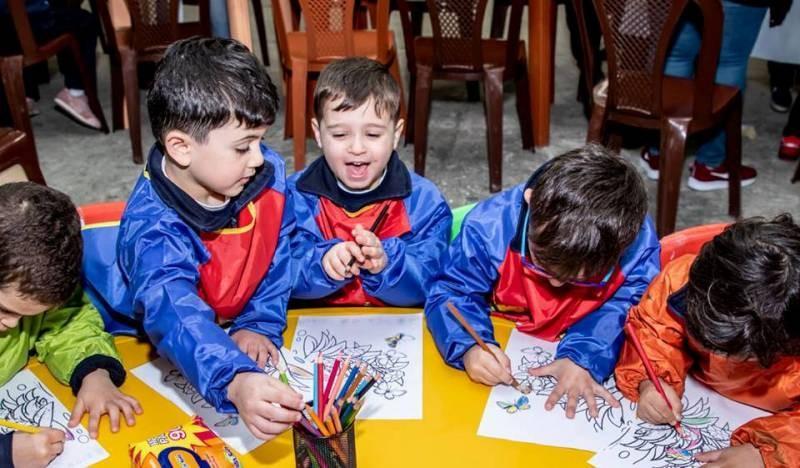 ملتقى الألوان يرسم إحتفالاً بعيد الطفل-بالصور