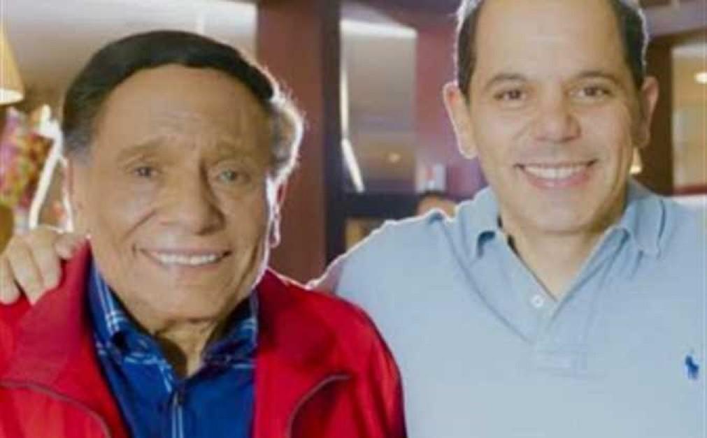 """خاص """"الفن""""- هل يتعمد إبن عادل إمام إخفاء أزمة والده الصحية خوفاً على تسويق مسلسله؟"""